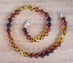 Dark Rainbow - Baltic Amber Teething Necklace. Image